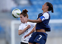 USA's Shannon Boxx fights for the ball with Germany's Verena Faibt during their Algarve Women's Cup soccer match at Algarve stadium in Faro, March 13, 2013.  .