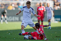 Michael Stephens of LA Galaxy is stopped by Dasan Robinson of Chicago Fire. The Chicago Fire beat the LA Galaxy 3-2 at Home Depot Center stadium in Carson, California on Sunday August 1, 2010.