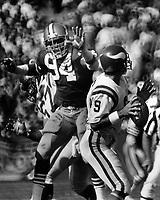 Minnesota Vikings quarterback Tommy Krammer rushed by San Francisco 49er Justin Smith. (1986 photo/Ron Riesterer)