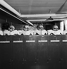 GPHR 45/5564:  Football helmets lined on top of lockers belonging to players Larry Conjar, Tom Regner, Nick Eddy, Jim Lynch, Pete Duranko, and Kevin Hardy in the Notre Dame Stadium locker room, 1966.  <br />