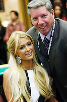 3 March 2007: Celebrity Paris Hilton poses with Mike Sexton while playing a poker hand in action  during the fifth annual WPT Invitational at the Commerce Casino in Los Angeles, CA.
