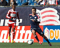 New England Revolution forward Diego Fagundez (14) on the attack. .  In a Major League Soccer (MLS) match, FC Dallas (red) defeated the New England Revolution (blue), 1-0, at Gillette Stadium on March 30, 2013.