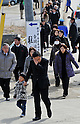 March 11, 2012, Rikuzentakata, Japan - Japanese families leave a joint memorial service in  Rikuzentakata, Iwate Prefecture, some 402 km northeast of Tokyo, on Sunday, March 11, 2012..Memorial ceremonies were held throughout Japan to mark the one year anniversary of the massive earthquake and tsunami that struck the country?fs northeastern region, killing just over 19,000 people and unleashing the world?fs worst nuclear crisis in a quarter century. The quake was the strongest recorded in the nation?fs history, and set off a tsunami that towered more than 65 feet in some spots along the northeastern coast, destroying thousands of homes and wreaking widespread destruction. (Photo by Natsuki Sakai/AFLO) AYF -mis-