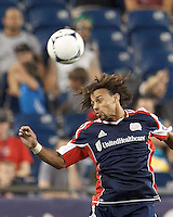 New England Revolution defender Kevin Alston (30) heads the ball. In a Major League Soccer (MLS) match, Montreal Impact defeated the New England Revolution, 1-0, at Gillette Stadium on August 12, 2012.