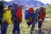 Backpackers in foothills of Alaska Range Siksikpalak River Arctic National Wildlife Refuge Alaska