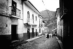 Local residents walk through the cobbled streets of Sorata, Bolivia..Photographer: Robert Gilhooly