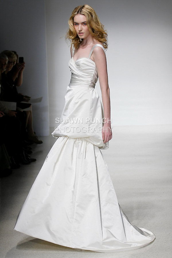 Model walks runway in a Selma wedding dress by Amsale Aberra, for the Christos Spring 2012 Bridal runway show.