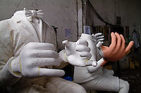 Unfinished man statues seen during the design process in the Carnival workshop in Rio de Janeiro, Brazil, 19 February 2004.