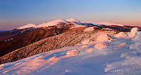 Sunset casts a warm glow on Mount Washington from Mount Pierce in the White Mountain National Forest.
