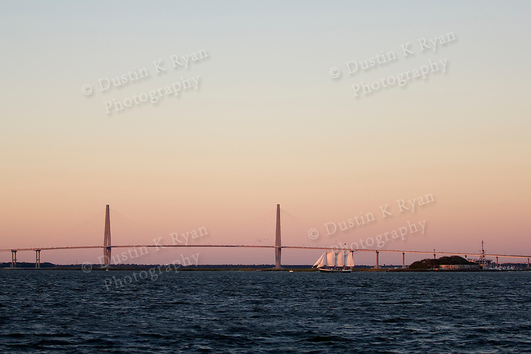 Schooner Pride Sailboat Sailing the Charleston Harbor during Sunset Arthur Ravenel Jr Bridge castle Pinckney