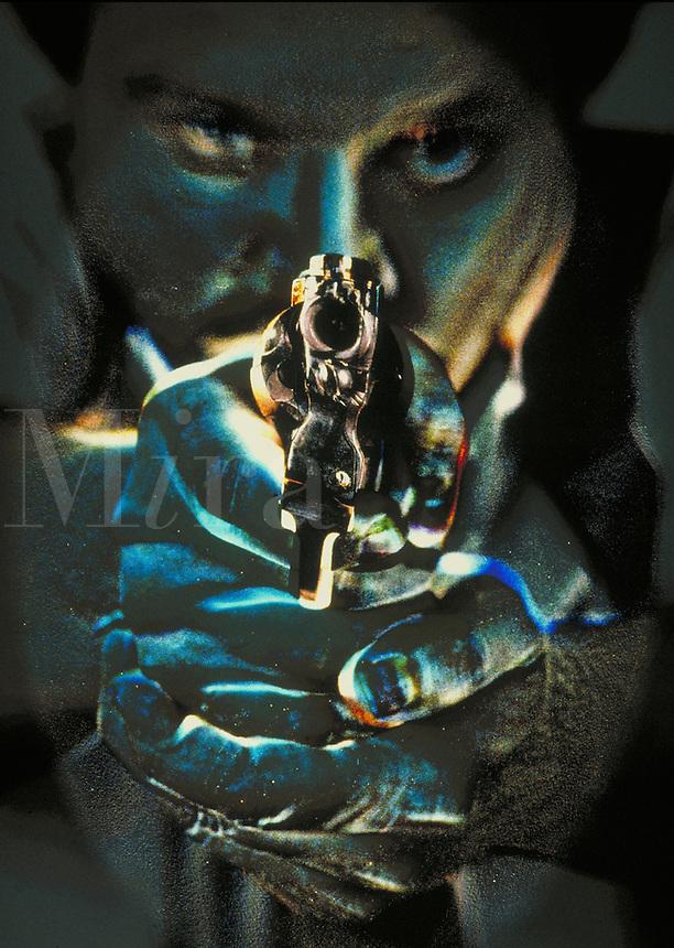 Man with handgun.