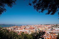 View of downtown Lisbon, Portugal, from S. Jorge Castle. The beautiful and picturesque downtown Lisbon, with the typical houses and small and narrow streets, was mainly built after the 1755 earthquake which leveled the city. The Tagus River and the 25 de Abril Bridge are also visible.