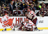 Vinny Saponari (BU - 27), Barry Almeida (BC - 9), Max Nicastro (BU - 7), Matt Price (BC - 25), Wade Megan (BU - 18) - Philip Samuelsson (BC - 5), Carl Sneep (BC - 7), Greg Brown (BC - Assistant Coach), Tommy Cross (BC - 4), Joe Whitney (BC - 15), Jerry York (BC - Head Coach), Cam Atkinson (BC - 13), Brian Gibbons (BC - 17), Ben Smith (BC - 12) - The Boston College Eagles defeated the Boston University Terriers 4-3 on Monday, February 8, 2010, at the TD Garden in Boston, Massachusetts, to take the 2010 Beanpot.