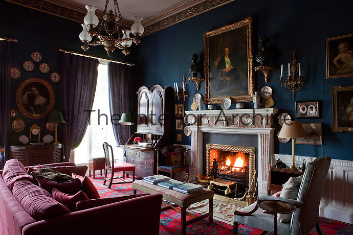 A portrait of the 4th Earl of Dunraven hangs above the fireplace in the living room
