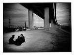 Conspiratorial schoolboys underneath expressway, Shin Koiwa, Chiba, Japan.