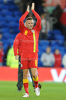 Cardiff City Stadium, Friday 11th Oct 2013. And that is it for me. Craig Bellamy of Wales who retires from International football applauds the Wales supporters at the end of the Wales v Macedonia FIFA World Cup 2014 Qualifier match at Cardiff City Stadium, Cardiff, Friday 11th Oct 2014. All images are the copyright of Jeff Thomas Photography-07837 386244-www.jaypics.photoshelter.com