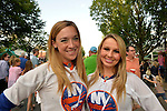 Garden City, New York, U.S. - June 6, 2014 -  L-R, ASHLEEN and JENNA, New York Islanders Ice Girls, are visitng the Garden City Belmont Stakes Festival, celebrating the 146th running of Belmont Stakes at nearby Elmont the next day. There was street festival family fun with live bands, food, pony rides and more, and a main sponsor of this Long Island night event was The New York Racing Association Inc.