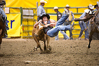 Steer wrestler Benjamin Carson leaps onto a steer at the College National Finals Rodeo in Casper, Wyo., Saturday, June 18, 2011. Unlike college athletes in other sports, student rodeo atheletes are allowed to compete for money and sign with sponsors. (Kevin Moloney for the New York Times)