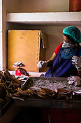A local worker weighs the herbs at the Pharmacy of the National Research Institute of Panchakarma in Cheruthuruthy in Thissur district of Kerala, India.