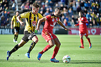 Nathan Burns ( Phoenix ) and Tarek Elrich ( Adelaide ) in action during the A League - Wellington Phoenix v Adelaide United at Hutt Recreational Ground, Lower Hutt, New Zealand on Saturday 7 March 2015. <br /> Photo by Masanori Udagawa. <br /> www.photowellington.photoshelter.com.