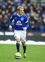 BOLTON, ENGLAND - Saturday, January 26, 2013: Everton's captain Phil Neville in action against Bolton Wanderers during the FA Cup 4th Round match at the Reebok Stadium. (Pic by David Rawcliffe/Propaganda)
