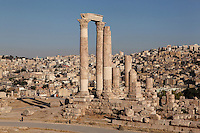 Temple of Hercules, Amman Citadel, Jabal al Qal'a, Amman, Jordan. This Roman temple was built in 162-66 AD and is dedicated to co-emperors Marcus Aurelius & Lucius Verus. Two visitors arriving at the site on the left of the picture give the scale of the imposing temple, cityscape of downtown Amman visible in the background. Picture by Manuel Cohen