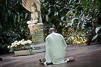 MAE CHEE MOLEE offers reverences at Buddha's altar during a course given to lay Buddhist in Sathira Dhammasathan meditation centre. She was ordainer as a nun just three months ago, but was serving as volunteer during 20 years at the Centre. Shatira Dhammasathan is a women's Dhamma centre, which provide since its foundation shelter to unwed mothers, young girls seeking escape from prostitution and helps provide education for young children.
