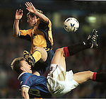 Stephane Guivarc'h tries an overhead kick but is clocked in the face by Martin Baker