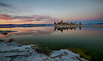 California, east central, Lee Vining. Tufas under a sunset sky on the shore of Mono Lake in autumn.