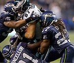 Philadelphia Eagles tight end Brent Celek is gang tackled by Seattle Seahawks Earl Thomas, left, Kam Chancellor and Earl Thomas at CenturyLink Field in Seattle, Washington on December 1, 2011. The Seahawks beat the Eagles 31-14. ©2011 Jim Bryant Photo. All Rights Reserved.