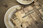 Chernobyl Exclusion Zone, Belarus. Newspaper 1986 left after evacuation. Houses 20 years after evacuation. Evacuated region designated as high risk for contamination of nuclear radiation. Homes are left derelict. The region has  become a natural wildlife reserve. It is controled by rangers, otherwise it is uninhabited. One of biggest dangers is a forest fire which could move large quantities of radioactivity by airborn means to areas otherwise unaffected.