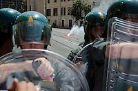 Roma 27 Giugno 2012.Manifestazione  dei sindacati di base  contro la riforma del lavoro e il ministro Fornero..La Guardia di Finanza blocca i manifestanti in via Manzoni che lanciano ortaggi e fumogeni