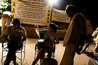 A homeless man speaks to the doctors (seated) at the mobile clinic in Jama Masjid on 4th October 2010, in Old Delhi, India. Picture: Suzanne Lee for The Australian.