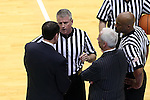 07 March 2015: Referee Bryan Kersey (center) explains a call to Duke head coach Mike Krzyzewski (left) as UNC head coach Roy Williams and referee Sean Hull (right) listen. The University of North Carolina Tar Heels played the Duke University Blue Devils in an NCAA Division I Men's basketball game at the Dean E. Smith Center in Chapel Hill, North Carolina. Duke won the game 84-77.