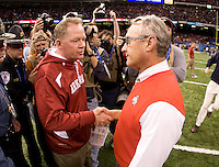 Ohio State head coach Jim Tressel shakes hands with Arkansas head coach Bobby Petrino after the game during 77th Annual Allstate Sugar Bowl Classic at Louisiana Superdome in New Orleans, Louisiana on January 4th, 2011.  Ohio State defeated Arkansas, 31-26.