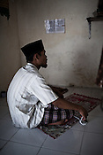 27 year old Maskuri prays in his house in Suradadi VIllage in Tegal of Central Java region in Indonesia. Photo: Sanjit Das/Panos