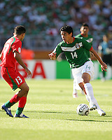 Gonzalo Pineda of Mexico gets ready to put a move on Hussein Kaabi of Iran. Mexico defeated Iran 3-1 during a World Cup Group D match at Franken-Stadion, Nuremberg, Germany on Sunday June 11, 2006.