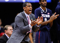 SOUTH BEND, IN - JANUARY 12: Head coach Kevin Ollie of the Connecticut Huskies is seen on the sidelines during the game against the Notre Dame Fighting Irish at Purcel Pavilion on January 12, 2012 in South Bend, Indiana. Connecticut defeated Notre Dame 65-58. (Photo by Michael Hickey/Getty Images) *** Local Caption *** Kevin Ollie