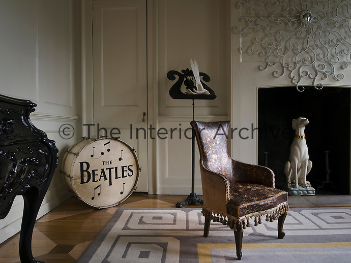 The white panelled drawing room is furnished with an eclectic mix of furniture and musical souvenirs