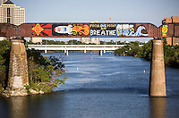 """Cool street art around Austin is not limited to sides of buildings, but also bridges as the Austin Railroad Graffiti Bridge over Lady Bird Town Lake contains famous pop-art graffiti paintings like the """"Focus One Point And Breathe"""" mural in downtown Austin, Texas."""