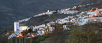 Capileira (above) and Bubion, with floodlit mudejar style Church of La Virgen del Rosari, 16th century (below), gorge of the Poqueira river, Alpujarra, Andalucia, Southern Spain. Moorish influence is seen in the distinctive cubic architecture of the Sierra Nevada's Alpujarra region, reminiscent of Berber architecture in Morocco's Atlas Mountains. Photograph by Manuel Cohen.)