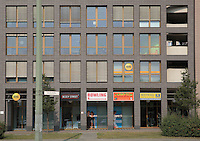 Facade of a modern building with shops on the ground floor on Grunerstrasse near Alexanderplatz, Mitte, Berlin, Germany. Picture by Manuel Cohen