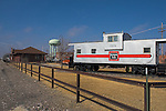 A restored CB&Q caboose is on display next to the Amtrak depot in downtown Holdrege, NE, 160 miles west of the state capital in Lincoln. This is one of the stops for the cross country Amtrak train, the California Zephyr.