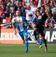 Marcelo Saragosa (11) of D.C. United tries to stop Jack McInerney (9) of the Philadelphia Union during the game at the RFK Stadium in Washington DC.  Philadelphia defeated D.C. United, 3-2.