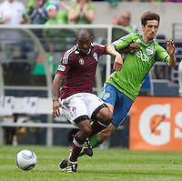 Colorado Rapids defender Marvell Wynne, left, and Seattle Sounders FC midfielder Alvaro Fernandez battle for the ball during play at CenturyLink Field in Seattle Sunday July 16, 2011. The Sounders won the game 4-3.