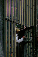 New Caledonia Glasshouse (formerly The Mexican Hothouse) built in the 1830s by Charles Rohault de Fleury, Jardin des Plantes, Museum National d'Histoire Naturelle, Paris, France. Detail showing a worker installing a new door to the passageway to the Tropical Rainforest Glasshouse (formerly Le Jardin d'Hiver or Winter Gardens), 1936, René Berger. The New Caledonia Glasshouse, or Hothouse, was the first French glass and iron building.