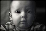 Close up of a baby staring into the camera