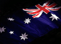 Australian flag coming out of dark background.<br /> <br /> Larger JPEG + TIFF images available by contacting use through our contact page at :..www.photography4business.com