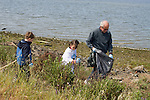 Oakland CA Grandfather and grandchildren; fivs and seven, working to clean up Alameda County Shoreline on Earth Day  MR