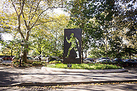 "The Ralph Ellison Memorial on Riverside Drive in Harlem  in New York on Saturday, October 26, 2013. The fifteen-foot high bronze monument to the author was designed by Elizabeth Catlett and represents Ellison's famous novel, ""Invisible Man"". . (© Richard B. Levine)"